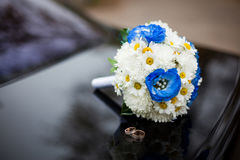 Wedding bouquet with eustomas. Blue wedding bouquet with eustomas and rings Royalty Free Stock Photos