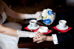 Wedding bouquet with eustomas and hands. Blue wedding bouquet with eustomas. Drinking coffee Royalty Free Stock Photos
