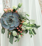 Wedding bouquet, exclusive, rich design Bride holding the wedding bouquet, close-up royalty free stock images