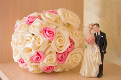Wedding bouquet and figurine Royalty Free Stock Photo