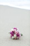Wedding bouquet flower on beautiful sand beach Royalty Free Stock Images
