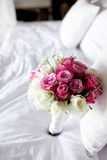 Wedding bouquet flower on bed Stock Image