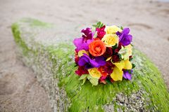 Wedding bouquet flower on tropical sand beach Stock Photos