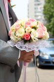 Wedding bouquet of flowers. Bridal wedding bouquet of flowers being held - detail Royalty Free Stock Photography