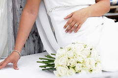 Wedding bouquet flowers. Young bride sitting with white wedding bouquet Royalty Free Stock Image