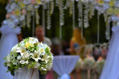 wedding bouquet of flowers against the background of the arch stock image