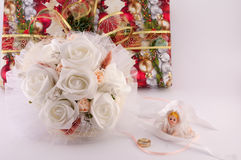 Wedding Bouquet of Flowers. Gifts and angel on a white background royalty free stock image