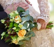 Wedding bouquet  flowers in hand of bride. Stock Photo