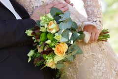 Wedding bouquet  flowers in hand of bride. Royalty Free Stock Photography