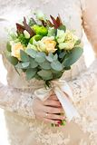 Wedding bouquet  flowers in hand of bride. Stock Image
