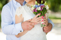 Wedding bouquet of flowers in hands of beautiful anonymous young Royalty Free Stock Photography