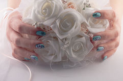 Wedding Bouquet of Flowers. Hands with beautiful nails holds a wedding bouquet of flowers royalty free stock photos