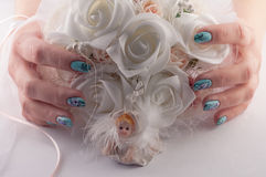 Wedding Bouquet of Flowers. Hands with beautiful nails holds a wedding bouquet of flowers stock photography