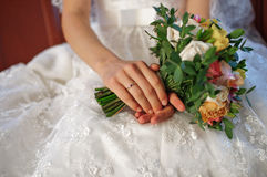Wedding bouquet of flowers in hands Royalty Free Stock Photo