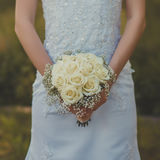 Wedding bouquet of flowers in hands of the bride. Royalty Free Stock Images