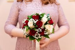 Bride holding her bouquet, closeup stock photography