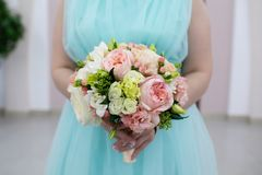 Bride holding her bouquet, closeup royalty free stock images
