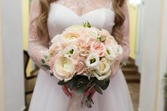 Bride holding her bouquet, closeup royalty free stock photography