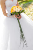 Wedding bouquet from  flowers in hands of the bride. Royalty Free Stock Image
