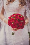 Wedding bouquet of flowers held by a bride Royalty Free Stock Image