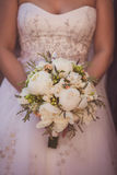 Wedding bouquet of flowers held by a bride Stock Image
