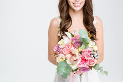 Wedding bouquet of flowers holded by happy young bride Stock Photo