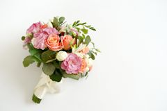 Wedding bouquet with flowers roses on a white background with copy space. minimal concept. mockup royalty free stock photos