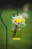 Wedding bouquet flowers yellow and white daisies. Along processional Stock Photography