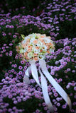 Wedding bouquet on flowery meadow Stock Image