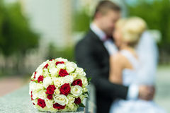 Wedding bouquet foreground. The wedding bouquet of roses on the marble surface Stock Photo