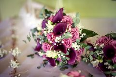A wedding bouquet of fresh flower, rose and calla stock photos