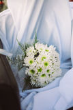 Wedding bouquet from fresh spring flowers. Bridal bouquet with white dahlia flowers on white cloth.  Stock Photos