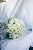Wedding bouquet from fresh spring flowers. Bridal bouquet with white dahlia flowers on white cloth.  Royalty Free Stock Photography