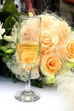 Wedding bouquet. And glass of champagne Stock Photography