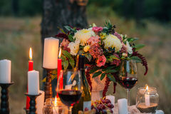 Wedding bouquet  with  glasses, vine,  candles and fruit outdoor Royalty Free Stock Photo