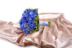 Wedding bouquet a golden fabric  on white background Stock Images