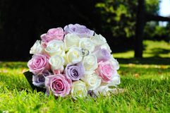 Wedding bouquet and golden rings Stock Photography