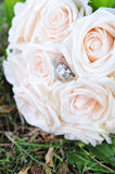Wedding bouquet and golden rings Stock Photos