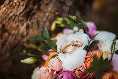 Wedding bouquet and golden rings Royalty Free Stock Photo