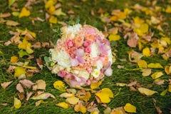 Wedding bouquet on grass in autumn Stock Photos