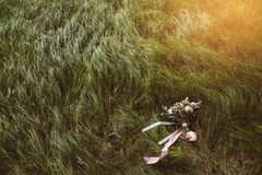 Wedding bouquet is on the grass. The bride`s bouquet stock photography