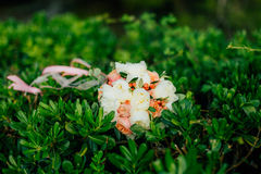 Wedding bouquet on the grass Stock Images