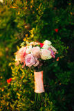 Wedding bouquet on a green background Royalty Free Stock Photography