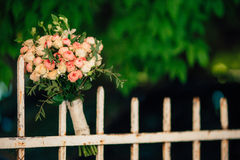 Wedding bouquet on a green background Royalty Free Stock Image