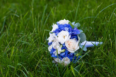 Wedding bouquet on the green grass Stock Photography