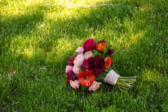 Wedding bouquet on green grass background Royalty Free Stock Image