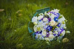 Wedding bouquet on the green grass Royalty Free Stock Image