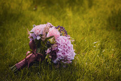 Wedding bouquet on the green grass Stock Photo