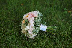 Wedding bouquet on green grass. Bride's flowers Royalty Free Stock Image