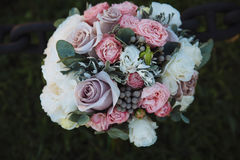Wedding bouquet on green grass. Bride`s flowers Royalty Free Stock Photos